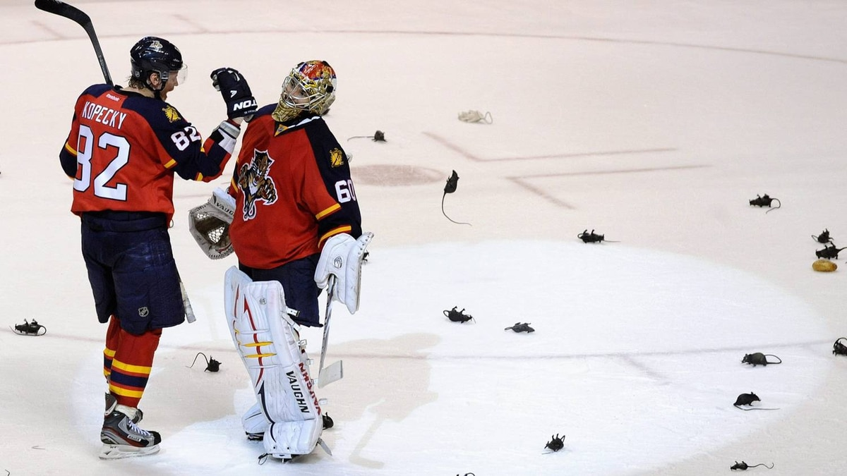 Florida Panthers' Tomas Kopecky (L) congratulates goalie Jose Theodore (R) on his shutout against the New Jersey Devils following their NHL Eastern conference quarterfinal playoff hockey Game 5 in Sunrise, Florida April 21, 2012.