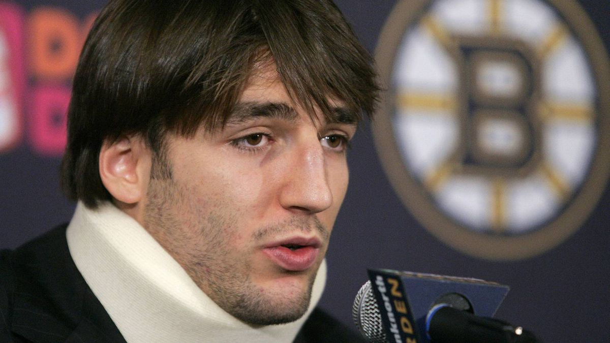 Boston Bruins centre Patrice Bergeron wears a neck brace as he faces reporters during a news conference in Boston on Nov. 8, 2007. Bergeron said the NHL must crack down on hits from behind, like the one he sustained during an Oct. 27 game against Philadelphia. It left him with a severe concussion and a broken nose