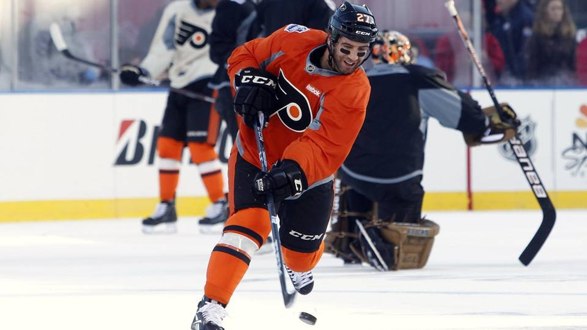 Philadelphia Flyers center Maxime Talbot shoots the puck during a practice session in preparation for the 2012 NHL Winter Classic ice hockey game at the Ballpark in Philadelphia, Pennsylvania January 1, 2012.