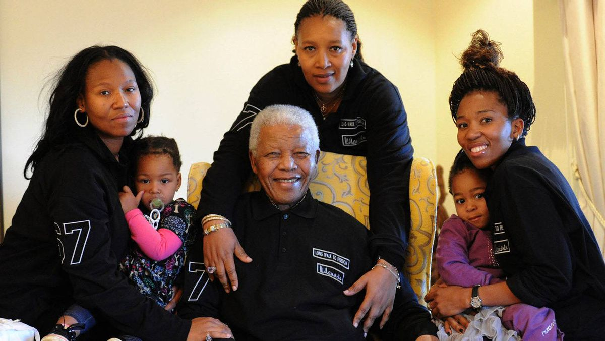 A picture released by the Mandela family shows South Africa's iconic elder statesman Nelson Mandela with family members as he prepares for his 93rd birthday in his home village of Qunu.