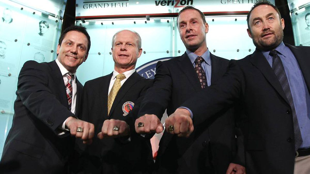 2011 Hall of Fame inductees Doug Gilmour, Mark Howe, Joe Nieuwendyk and Ed Belfour show off their Hall of Fame rings during a photo opportunity at the Hockey Hall of Fame on Monday.