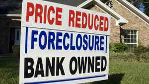 A residential foreclosure sign.
