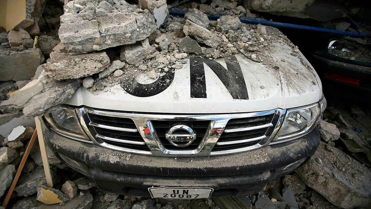 A UN car is covered in rubble on Jan. 13, 2010, the day after an earthquake hit Port-au-Prince, Haiti. The United Nations headquarters in the capital was demolished and dozens of its employees were missing.