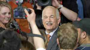 NDP Leader Jack Layton greets supporters in Toronto after his party surged to Official Opposition status in the May 2, 2011 federal election.