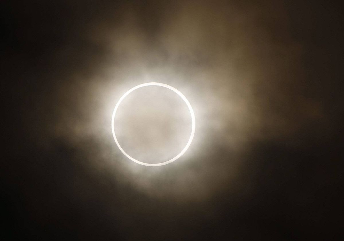 The moon slides across the sun, showing a blazing halo of light, during an annular eclipse at a waterfront park in Yokohama, near Tokyo, Monday, May 21, 2012.