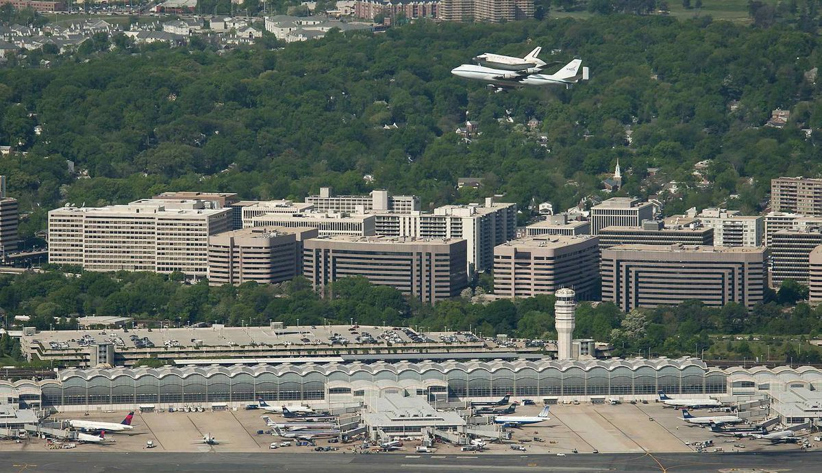 Space Shuttle Discovery, mounted atop a NASA 747 Shuttle Carrier Aircraft (SCA), makes its way past Ronald Reagan Washington National Airport in Washington