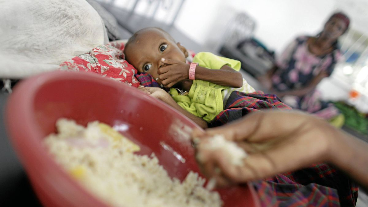 Children and their mothers receive food and treatment, mostly for severe malnutrition and measels, at a hospital in Mogadishu, Somalia, on Sept. 7, 2011.