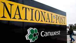 A pedestrian walks past the front of the National Post sign in Toronto on Feb. 27, 2009. Winnipeg-based Canwest, carrying a $3.9-billion debt load overall, is riding a deadline for renegotiating terms of a debt that represents a small portion of its total debt.