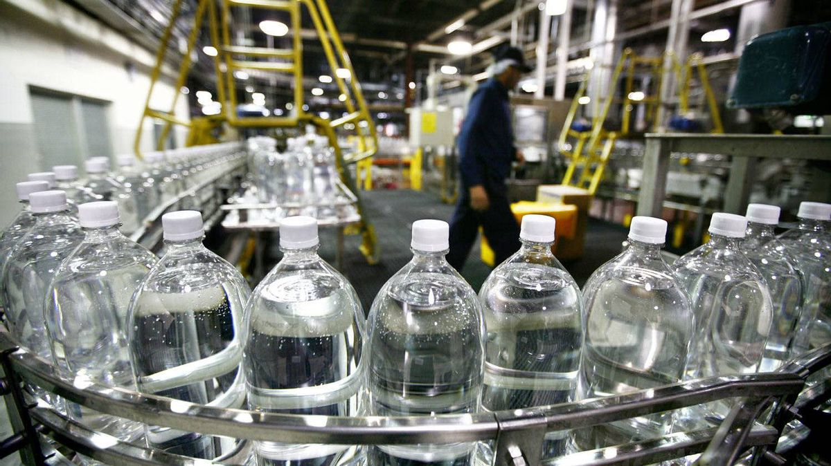 Toronto, November 20 2009 Plastic bottles filled with soda prior to be labelled are carried on conveyor belt at the soft drink maker Cott's bottling plant near Pearson Airport, Toronto.