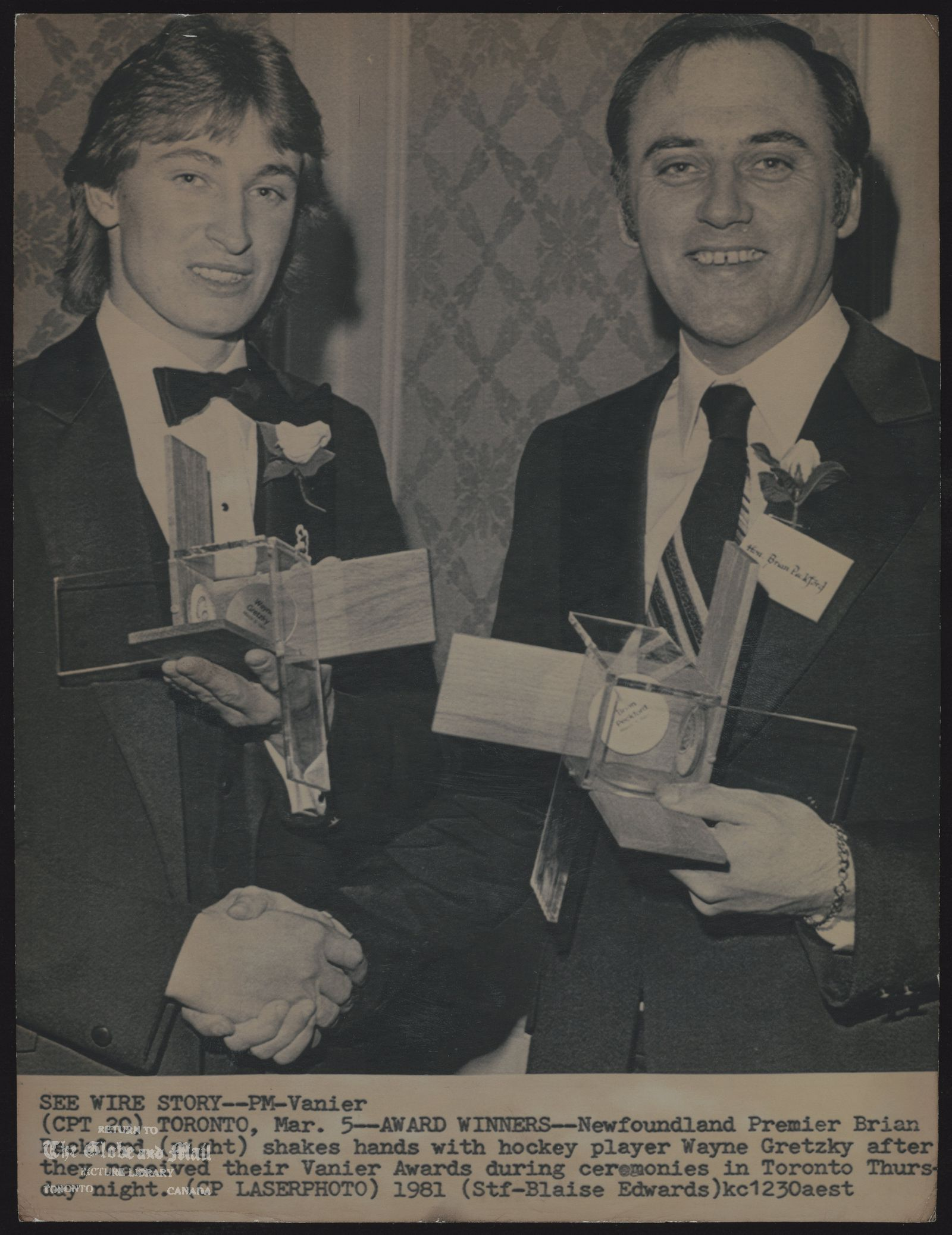 Wayne GRETZKY Hockey player SEE WIRE STORY--PM--Vanier (CPT 20) TORONTO, Mar. 5--AWARD WINNERS--Newfoundland Premier Brian Peckford (right) shakes hands with hockey player Wayne Gretzky after they received their Vanier Awards during ceremonies in Toronto Thursday night. (CP Laserphoto) 1981 (Stf-Blaise Edwards) kc123aest