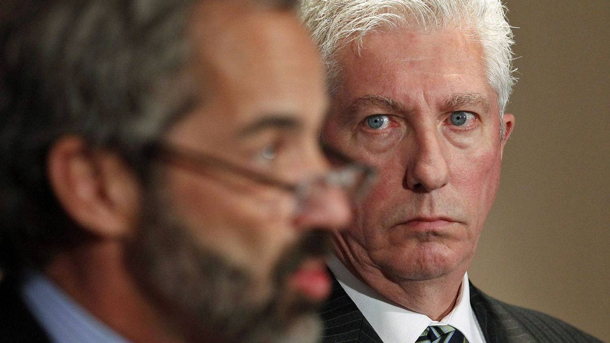 Bloc Leader Gilles Duceppe looks on as MP Daniel Paille speaks to reporters after the party's caucus meeting in Quebec City on Jan. 27, 2011.