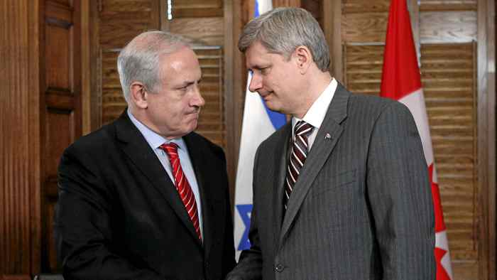 Canada's Prime Minister Stephen Harper shakes hands with Israel's Prime Minister Benjamin Netanyahu during a meeting in Harper's office on Parliament Hill in Ottawa May 31, 2010.