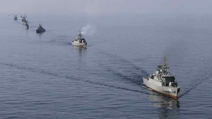 Iranian naval ships take part in a naval parade on the last day of the Velayat-90 war game in the Sea of Oman near the Strait of Hormuz in southern Iran Jan. 3, 2012.