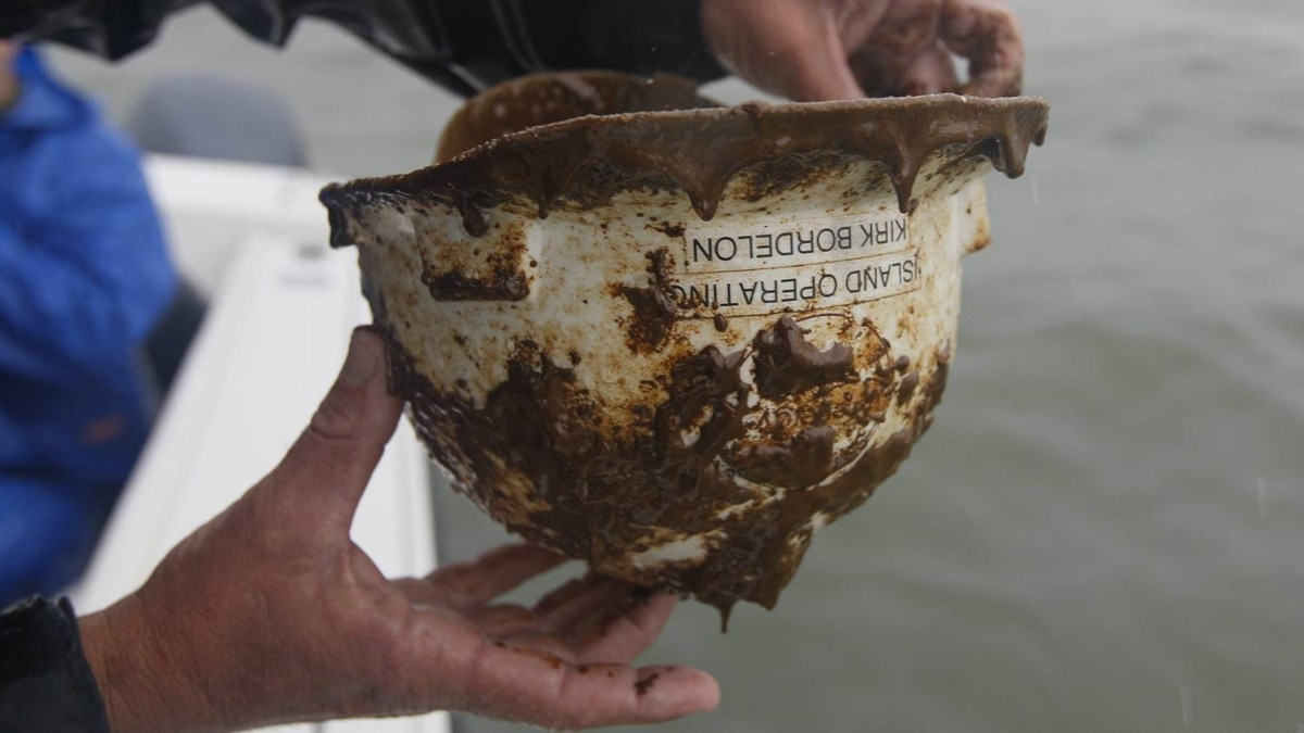 A hard hat covered in oil is found in the waters of Chandeleur Sound, La.,