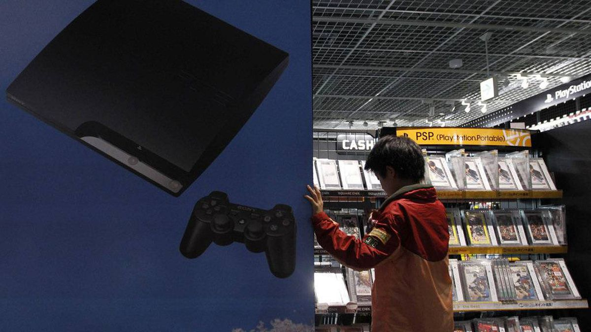 A boy chooses Sony's Playstation game software at an electronic shop in Tokyo May 5, 2011. Sony Corp blamed Internet vigilante group Anonymous for indirectly allowing a hacker to gain access to personal data of more than 100 million video game users.