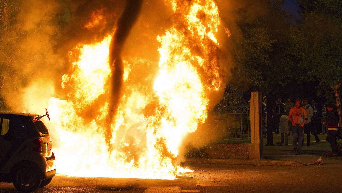 A small tornado forms inside the fire of a burning car during riots in Vancouver, British Columbia June 16, 2011.