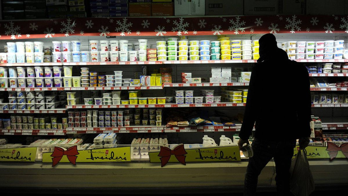 A shopper chooses among dairy products at a Kensington Market shop. The updated Consumer Price Index will be released on Tuesday.