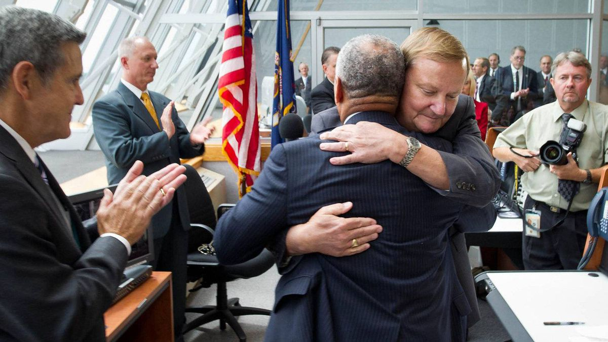 NASA Administrator Charles Bolden hugs Launch Director Michael Leinbach (R) in the firing room of the Launch Control Center shortly after the space shuttle Atlantis launched in this photo provided by NASA and taken July 8, 2011.