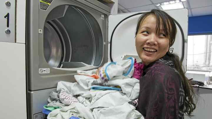 """Rody Shakhel does her laundry regularly at the recently opened laundromat """"Quick Clean"""" in Satya Vihar, New Delhi. Quick Clean is the first laundromat in India."""