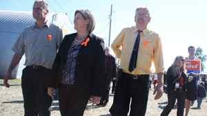 Ontario NDP leader Andrea Horwath tours the New Liskeard fall fair with local NDP candidate John Vanthof (left).
