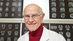 Dr. Charles Tator is seen with MRI brain scans at Toronto Western Hospital on Feb. 6, 2011.
