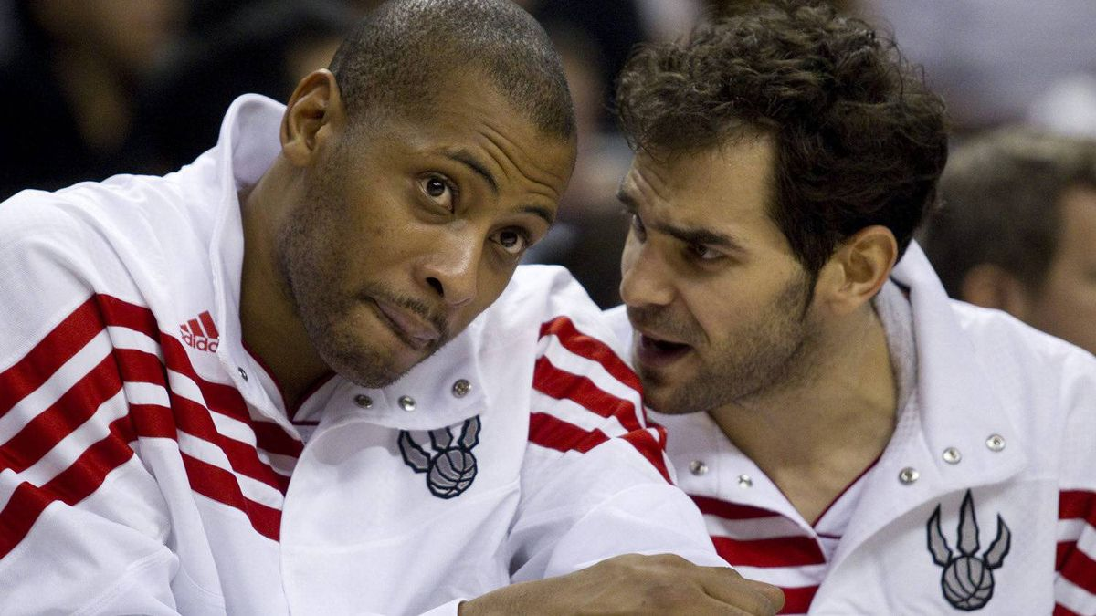 Toronto Raptors' Jamaal Magloire (left) talks with Jose Calderon on the bench during the second half of NBA basketball pre-season action against the Boston Celtics in Toronto on Sunday December 18, 2011. THE CANADIAN PRESS/Pawel Dwulit