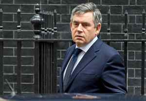 British Prime Minister Gordon Brown leaves 10 Downing Street in London on Oct. 14, 2009.