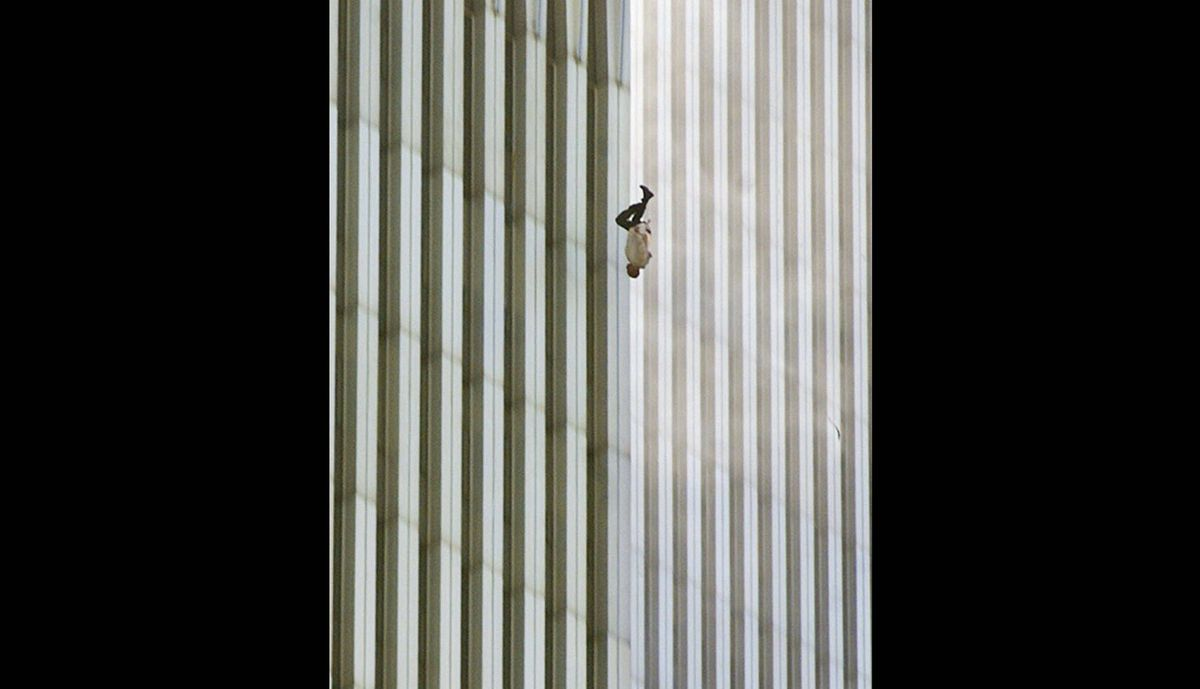 "In this Tuesday, Sept. 11, 2001 file picture, a person falls headfirst from the north tower of New York's World Trade Center. This photo later became known as ""The Falling Man""."