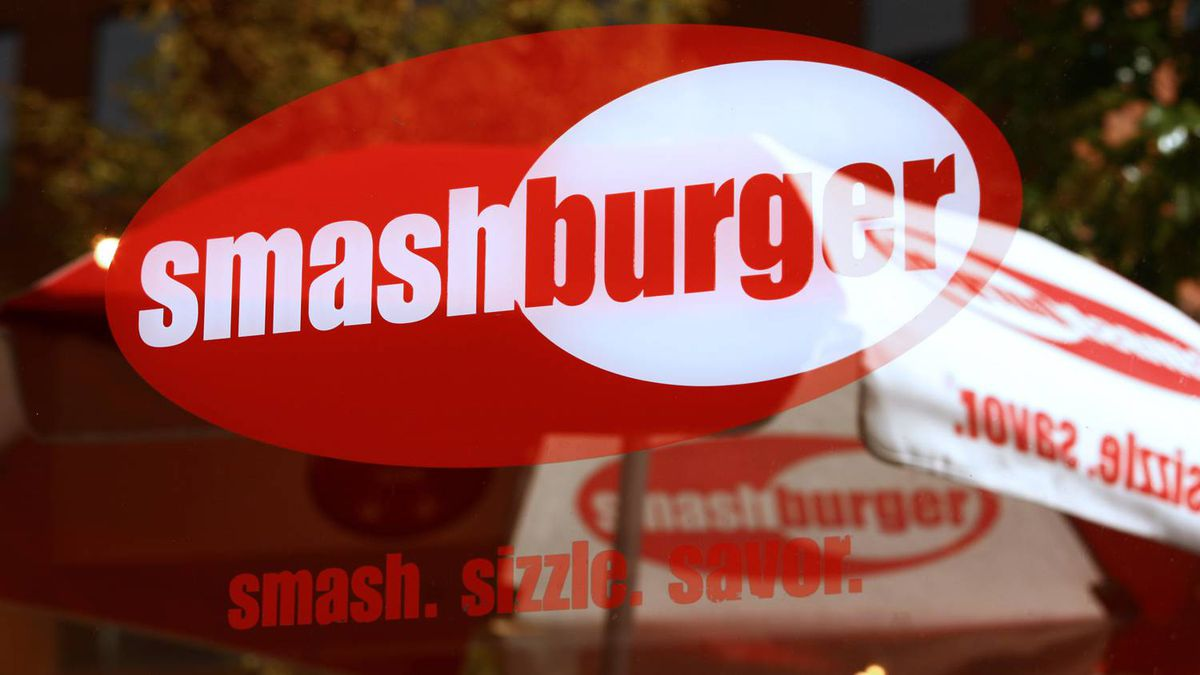 Smashburger signage is displayed in the window a restaurant in Denver.