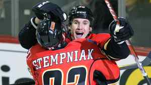 Calgary Flames' Curtis Glencross (R) celebrates his goal with teammate Lee Stempniak during the third period of their NHL hockey game against the Colorado Avalanche in Calgary, Alberta, December 8, 2011.
