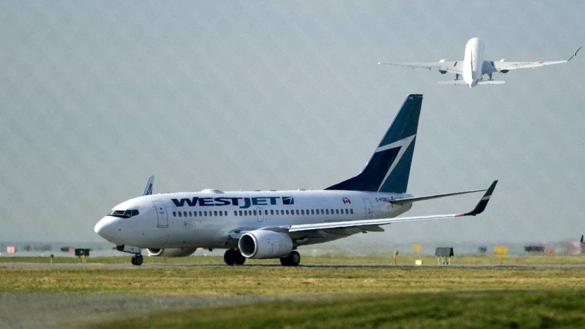 A West Jet Boeing 737-700 aircraft departs Vancouver International Airport in Richmond, British Columbia Feb. 9, 2011.