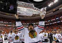 Blackhawks Keith celebrates with the Stanley Cup after the Blackhawks defeated the Philadelphia Flyers in Philadelphia