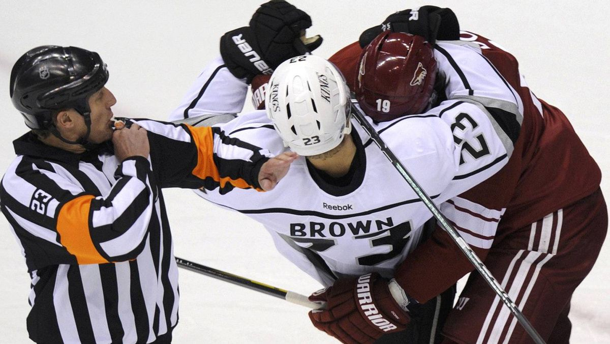NHL Referee Brad Watson (23) blows his whistle as Phoenix Coyotes right wing Shane Doan (19) and Los Angeles Kings right wing Dustin Brown (23) mix it up in the 1st period during Game 1 of the NHL Western Conference hockey finals in Glendale, Arizona, May 13, 2012. REUTERS/Todd Korol