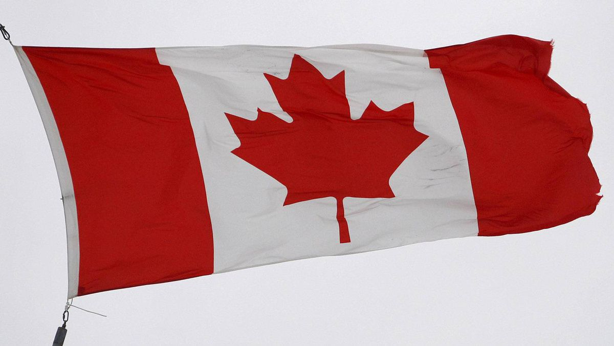The Canadian flag flutters in the wind