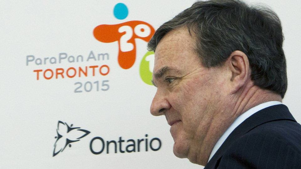 Federal Finance Minister Jim Flaherty arrives for an update news conference regarding the 2015 Pan Am Games in Toronto on Friday.