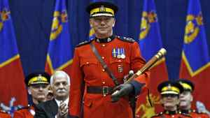 New Royal Canadian Mounted Police Commissioner Bob Paulson holds the Tipstaff during a change of command ceremony in Ottawa Dec. 8, 2011.