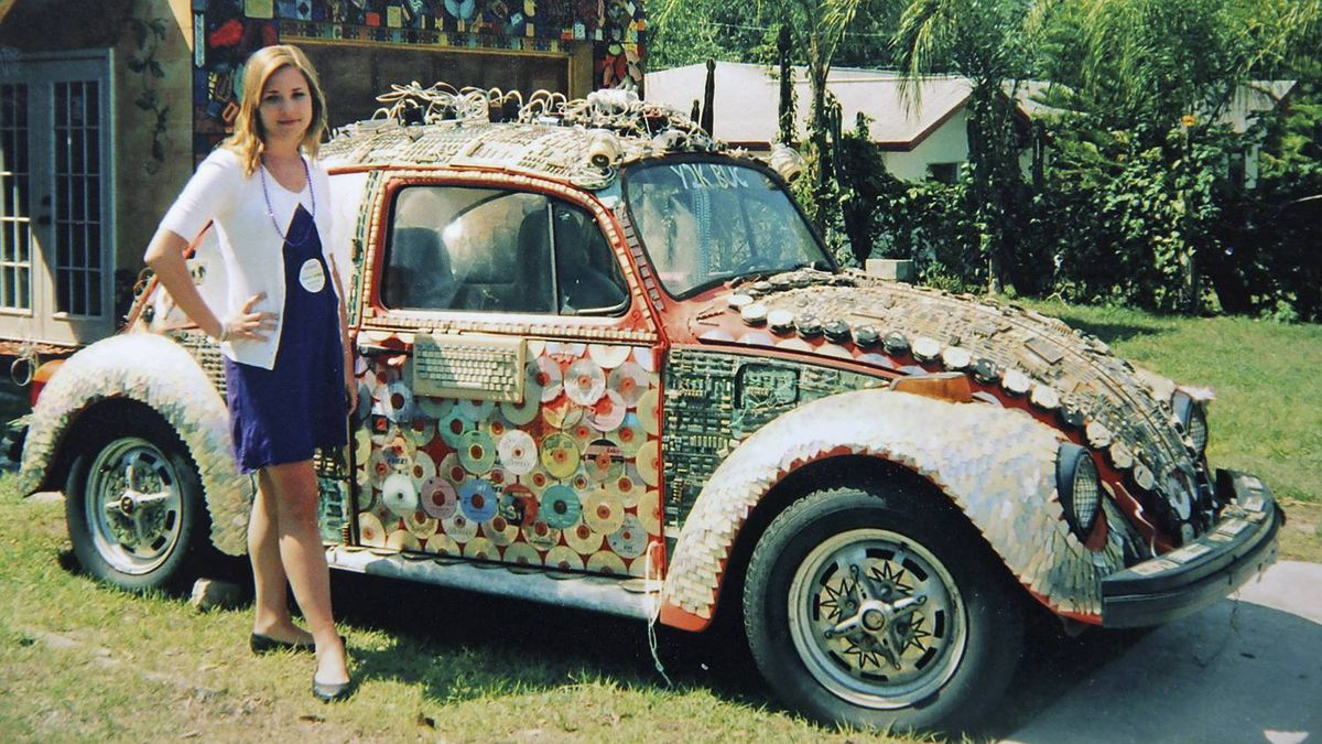 Peter Cheney's daughter Cate with a VW Beetle art car in Florida.