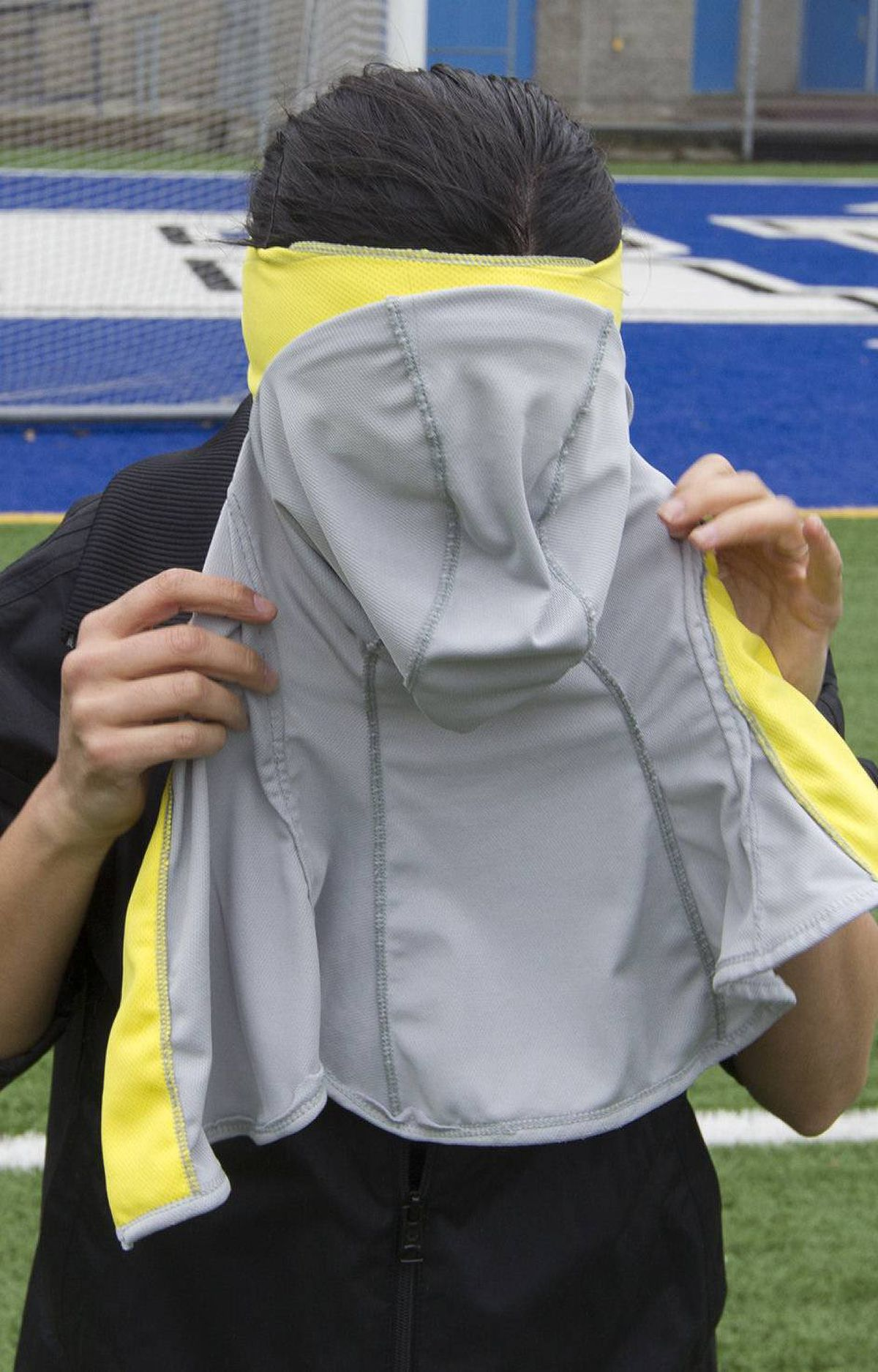 Elham Seyed Javad shows how to wear her design for a sports hijab in Montreal, May 1, 2012. Her design is in competition to become the headscarf chosen by FIFA, which is lifting its ban on the head coverings in soccer.