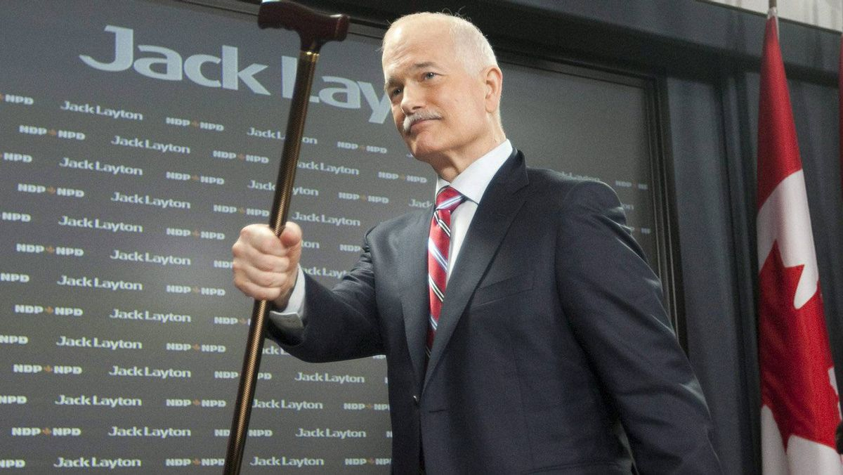 NDP Leader Jack Layton raises his cane as leaves a news conference in Ottawa, Monday April 11, 2011 after speaking about the Auditor-General's report on the G8. Layton died at his Toronto home this morning at the age of 61.