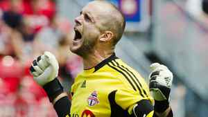 Toronto FC goalkeeper Stefan Frei celebrates after his team defeated the Vancouver Whitecaps to win the Canadian Championship final soccer match in Toronto, July, 2, 2011. REUTERS/Mark Blinch