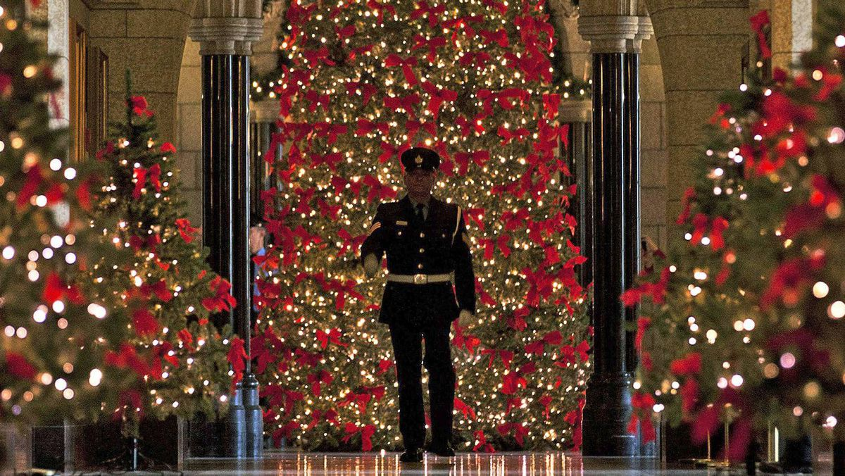 A House of Commons security guard walks through the decorated halls Parliament on Dec. 9, 2011.