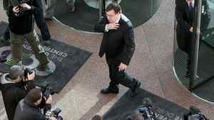 """Irish Prime Minister Brian Cowen (C) is greeted by camera crews and photographers as he arrives to address the IBM Smart Camp Global Final event in Dublin, Ireland, on November 18, 2010. Ireland could receive """"tens of billions"""" of euros as part of an EU-IMF bailout, the head of Ireland's Central Bank said Thursday as an international mission of experts arrived in the country."""