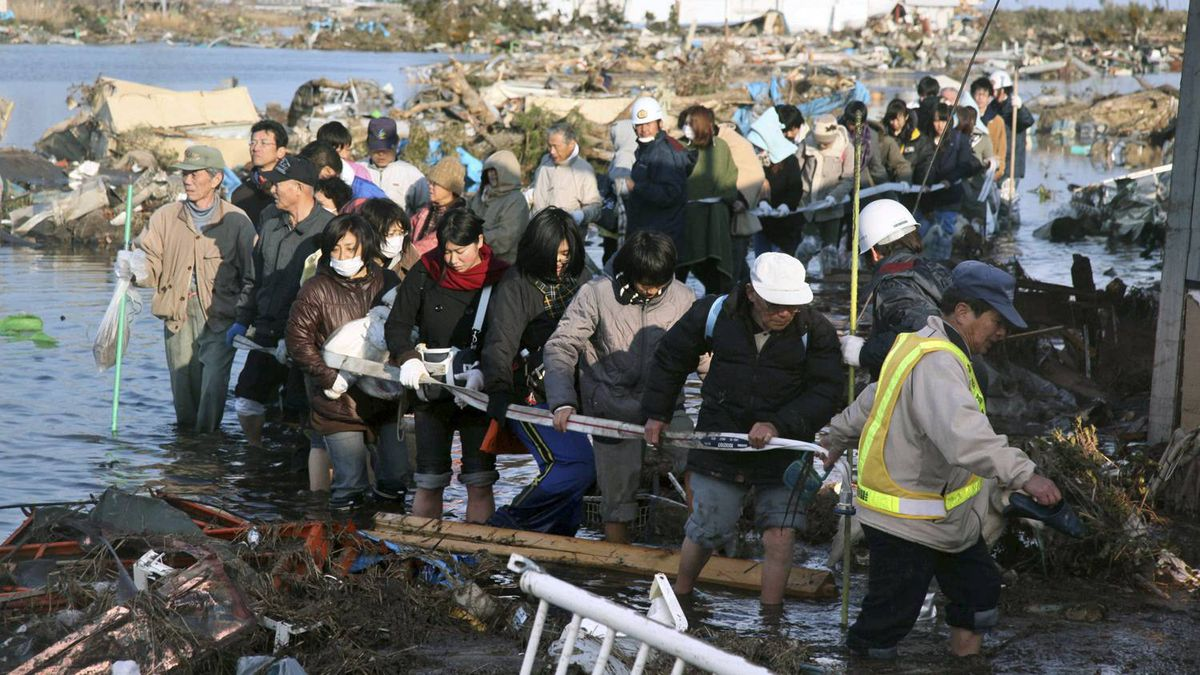 People who were isolated at an elementary school, head for safety place in Sendai, northern Japan Saturday, March 12, 2011 after one of the country's strongest earthquakes ever recorded hit its eastern coast on Friday.