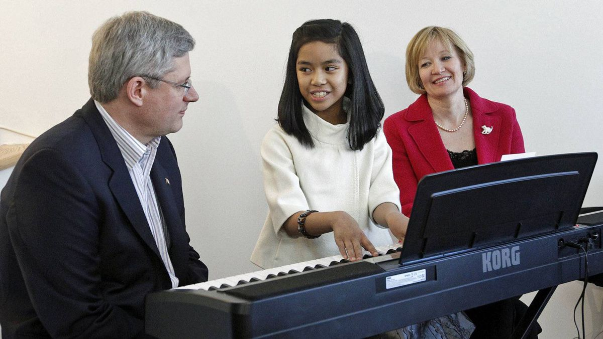 Conservative Leader Stephen Harper, YouTube sensation Maria Aragon and Laureen Harper at a campaign stop in Winnipeg on March 29, 2011.