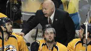Nashville Predators coach Barry Trotz talks with players, including Paul Gaustad, left; Alexander Radulov, center, of Russia; and David Legwand, right, during a timeout in the third period of an NHL hockey game against the Dallas Stars on Thursday, April 5, 2012, in Nashville, Tenn. The Predators won 2-0. (AP Photo/Mark Humphrey)