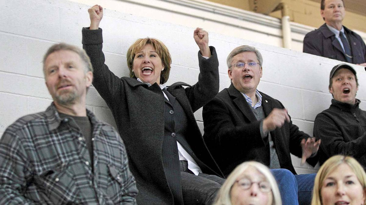 Canadian Prime Minister Stephen Harper and B.C. Premier Christy Clark cheer as Clark's 10 year-old son Hamish makes a save during a minor league hockey game in Vancouver. Harper, an avid hockey fan, attended the game during a visit to Vancouver on Thursday.