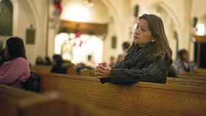 Fay Arellano prays at Our Lady of the Assumption Catholic Church in Toronto.