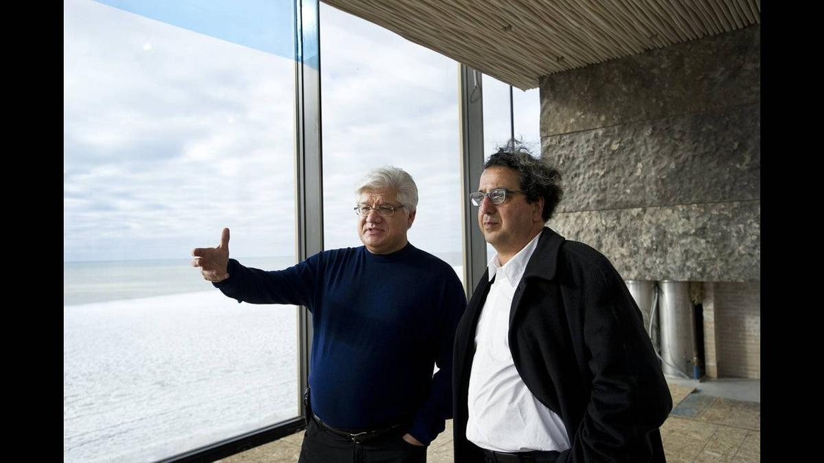 Former RIM co-CEO Mike Lazaridis, left, and Architect Siamak Hariri talk at Lazaridis' property located near Amberley, ON. Feb. 1, 2012.