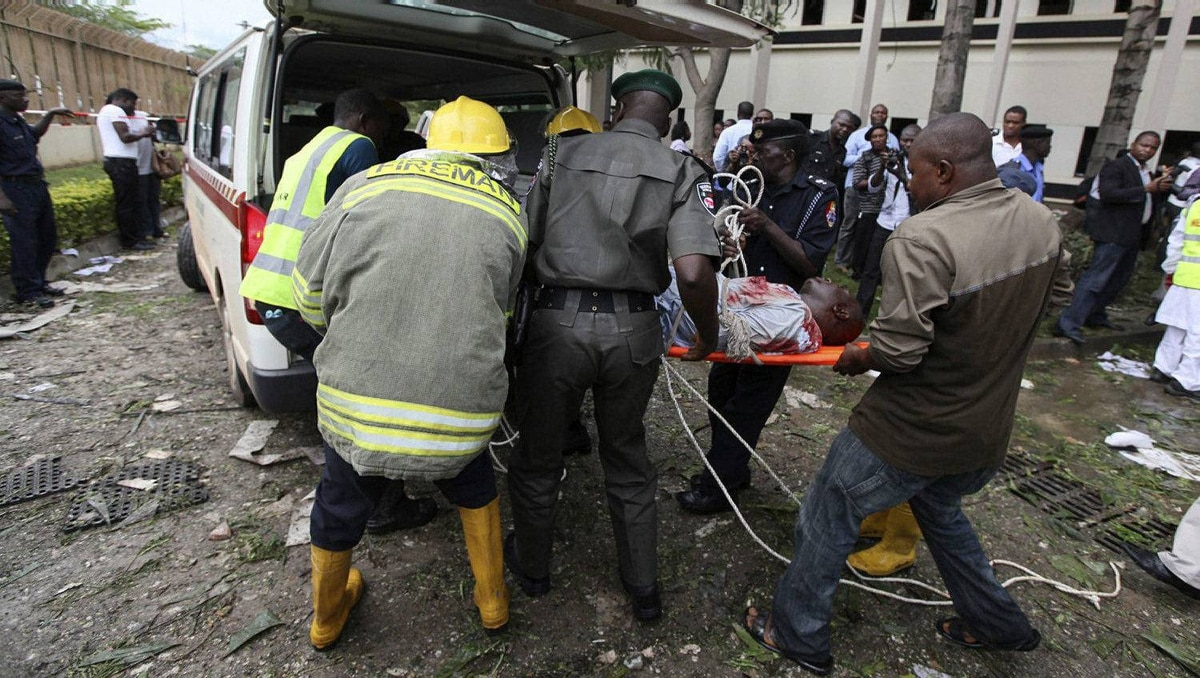 A victim of a bomb blast ripped through the United Nations offices in the Nigerian capital of Abuja is loaded into an ambulance, August 26, 2011, after a car rammed into the building, and witnesses said they had seen a number of dead bodies being carried from the site.