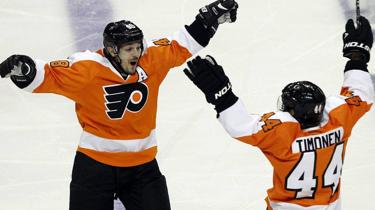 Philadelphia Flyers center Danny Briere (48) reacts with Kimmo Timonen (44), from Finland, after Briere scored the winning goal in the overtime period of Game 1 in a second-round NHL Stanley Cup hockey playoff series with the New Jersey Devils, Sunday, April 29, 2012, in Philadelphia. The Flyers won 4-3 in overtime. (AP Photo/Alex Brandon)